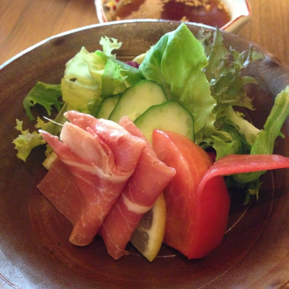 Green salad with prosciutto ham
