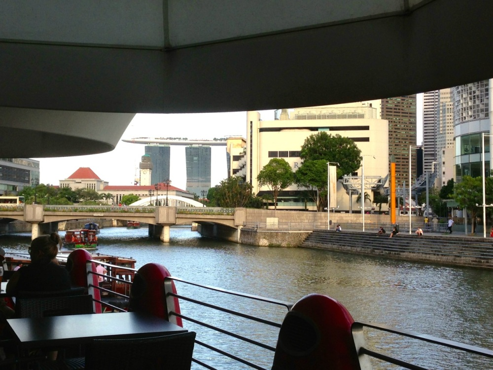 Sitting by Singapore River