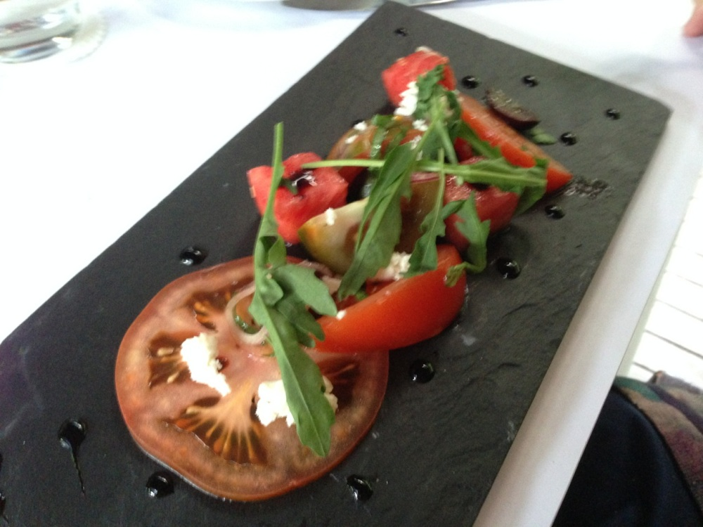 Salad of heirloom tomato, watermelon, Meredith goat's cheese, balsamic and black olive