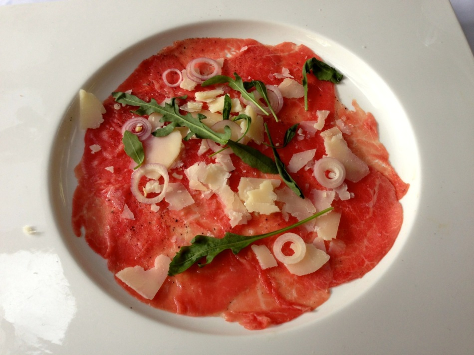 Mayura Station Wagyu beef carpaccio with frisee, parmesan and truffle oil