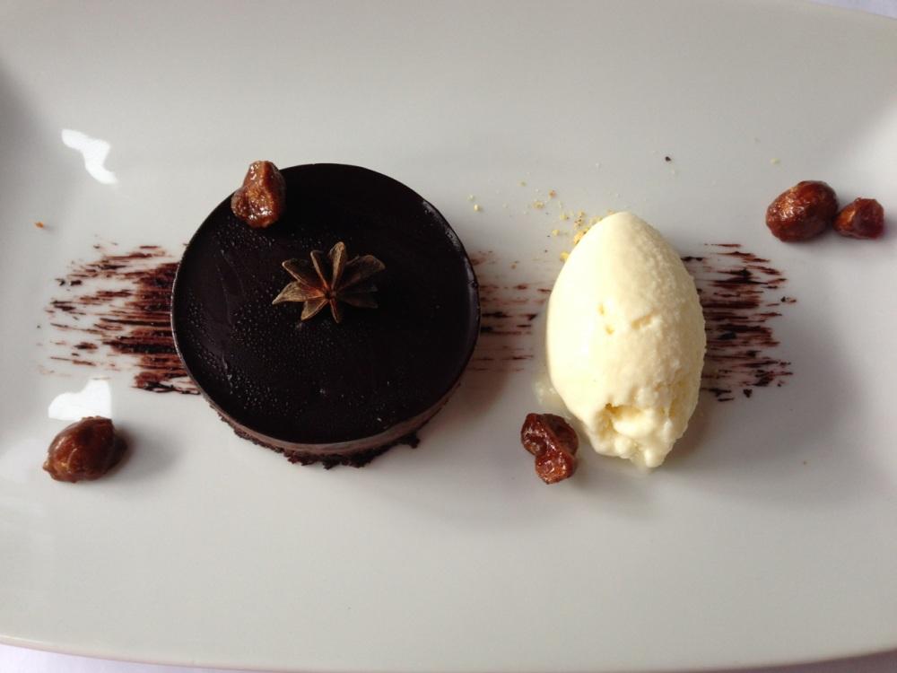 Star anise chocolate tart, white chocolate ice cream and candied macadamia