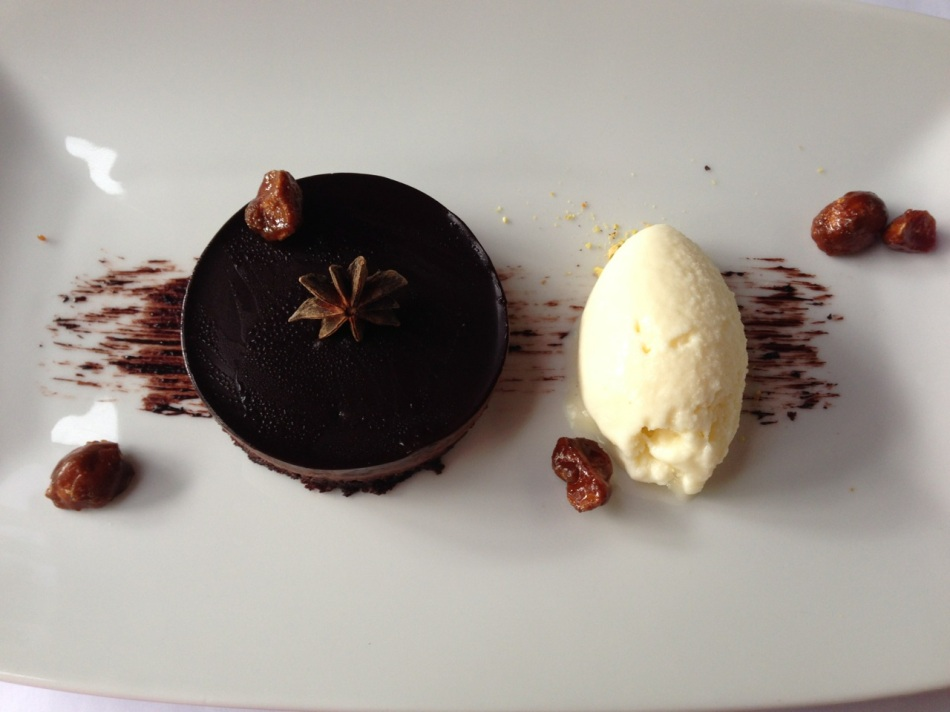 Star anise chocolate tart, white chocolate ice cream and candied macadamia
