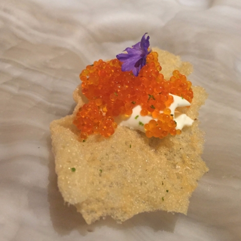 Fish cracker with creme fraiche and tobiko