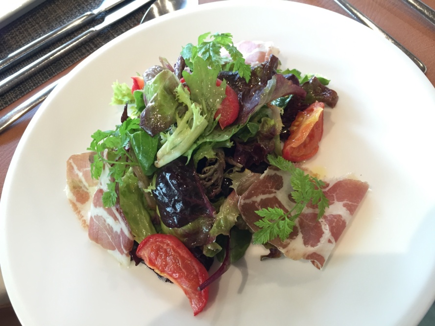 Air Dried Coppa Ham with mesclun and vine tomato confit with honey mustard apple dressing
