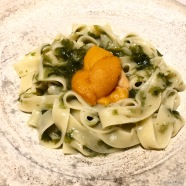 "Homemade pasta with ""Aonori"" seaweed sauce topped with ""Bafun"" uni"