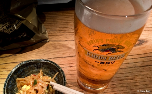 A nice cold beer with pickled bean sprouts