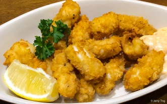 Calamares Fritos • Fried battered squid, served with house sauce