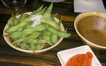 Spicy edamame, boiled whole soy beans with a spicy sauce