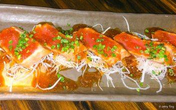 Tuna tataki, lightly seared tuna with soy, yuzu and shallot dressing on shredded daikon