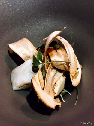 poached piece of sea bass, Brazilian mushrooms, sprouted lentils