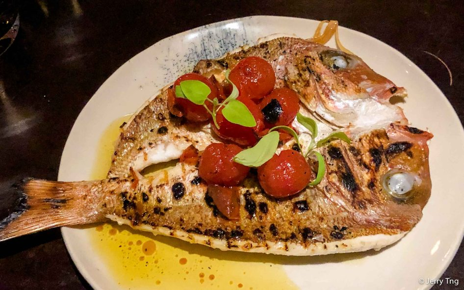 Butterflied sea bream, tomato, oregano