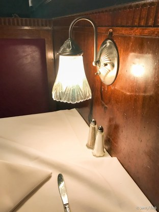 Dining booth with the quaint little lamp