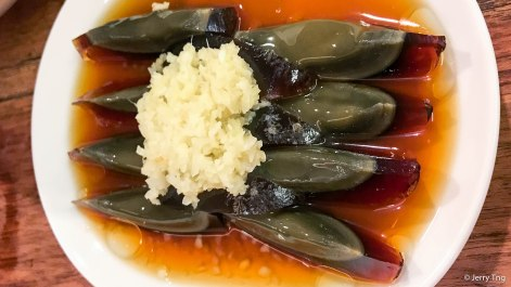 century egg with minced garlic and vinegar (2017)